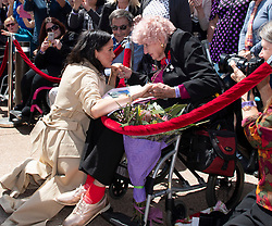 The Duchess of Sussex meets 98 year old Daphne Dunne during a walkabout outside the Sydney Opera House on the first day of the Royal couple's visit to Australia.