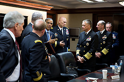 President Barack Obama talks with the Joint Chiefs of Staff following a meeting in the Situation Room of the White House, Oct. 28, 2014. Standing with President from left are: Defense Secretary Chuck Hagel; Gen. Martin Dempsey, Chairman of the Joint Chiefs of Staff; Robert Work, Deputy Secretary of Defense; Gen. Raymond Odierno, Chief of Staff of the Army; Adm. James A. Winnefeld, Jr., Vice Chairman of the Joint Chiefs of Staff; Adm. Jonathan Greenert, Chief of Naval Operations; and Gen. Mark Welsh, Chief of Staff of the Air Force. (Official White House Photo by Pete Souza)<br /> <br /> This official White House photograph is being made available only for publication by news organizations and/or for personal use printing by the subject(s) of the photograph. The photograph may not be manipulated in any way and may not be used in commercial or political materials, advertisements, emails, products, promotions that in any way suggests approval or endorsement of the President, the First Family, or the White House.