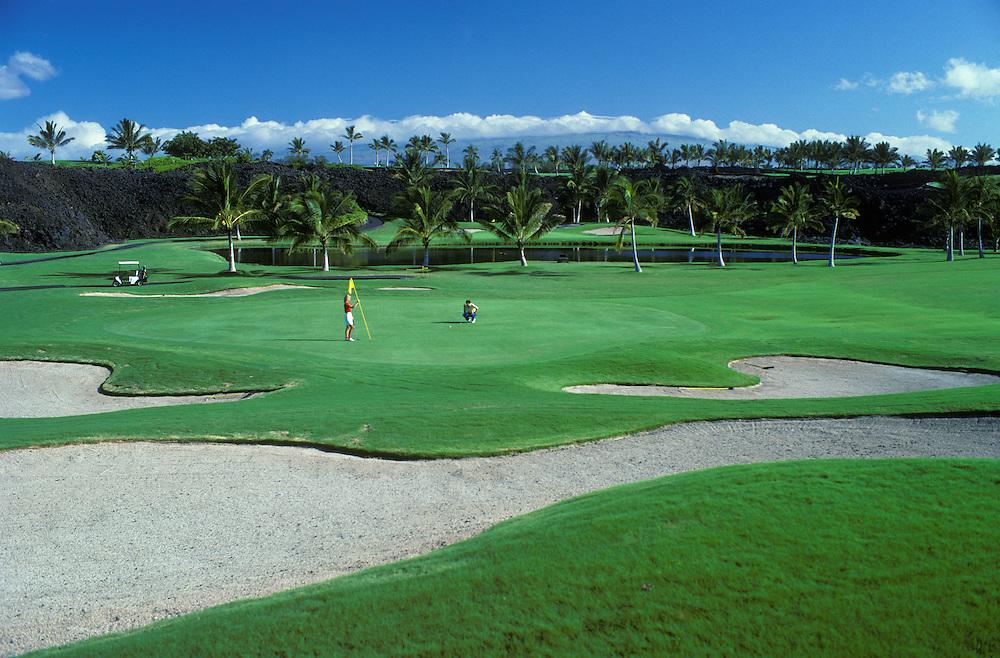 Waikoloa Beach Resort: couple golfing at 3rd hole of Beach Course; Kohala Coast, Island of Hawaii.