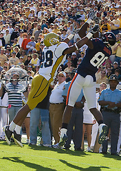 Georgia Tech cornerback Rashaad Reid (28) forces Virginia wide receiver Maurice Covington (80) out of bounds on a catch in the end zone.  The play was ruled an incomplete pass.  The Virginia Cavaliers defeated the #18 ranked Georgia Tech Yellow Jackets 24-17 in NCAA Division 1 Football at Bobby Dodd Stadium on the campus of Georgia Tech in Atlanta, GA on October 25, 2008.