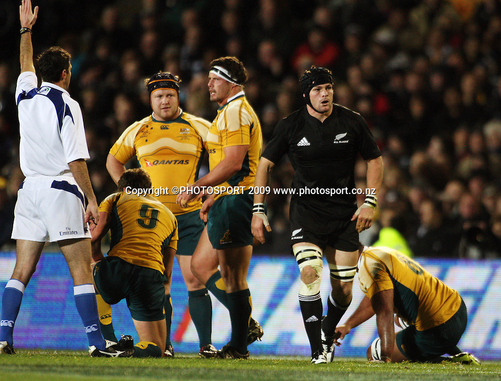 All Blacks captain Richie McCaw walks back after Australia are awarded a penalty by referee Craig Joubert.<br /> Tri Nations - All Blacks v Australia at Eden Park, Auckland, New Zealand. Saturday 14 July 2009. Photo: Dave Lintott/PHOTOSPORT