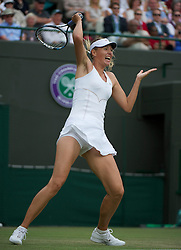 LONDON, ENGLAND - Friday, June 24, 2011: Maria Sharapova (RUS) in action during the Ladies' Singles 2nd Round match on day five of the Wimbledon Lawn Tennis Championships at the All England Lawn Tennis and Croquet Club. (Pic by David Rawcliffe/Propaganda)