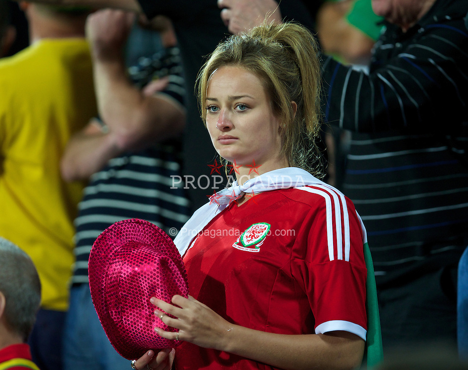 ANDORRA LA VELLA, ANDORRA - Tuesday, September 9, 2014: A female Wales supporter during the opening UEFA Euro 2016 qualifying match against Andorra at the Camp d'Esports del M.I. Consell General. (Pic by David Rawcliffe/Propaganda)