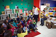 Daniele Belmonte leads a session with the children inside the library.