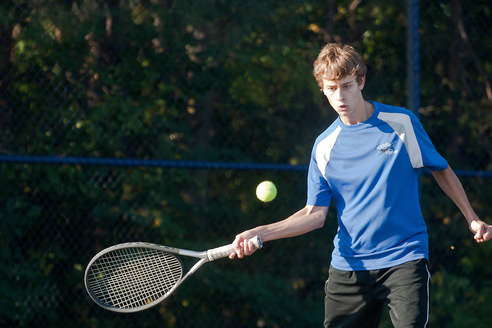 Lathan Goumas | The Bay City Times..Jason Payne of the Nouvel Catholic Central High School tennis team hits the ball during the first round of the 2011 City By the Bay Invitational Tennis Tournament at Garber High School in Essexville, MI., on Saturday September 24, 2011.