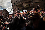 Demonstrators carry the body of Macen Abul Dahad, 23, a fighter from the Free Syrian Army shot in combat with security forces, in Sakba, in the outskirts of Damascus, January 27, 2012, Photo/Tomas Munita
