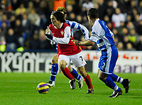 Photo: Leigh Quinnell/Sportsbeat Images.<br /> Reading v Arsenal. The FA Barclays Premiership. 12/11/2007. Arsenals Tomas Rosicky braeks past Readings Graeme Murty.