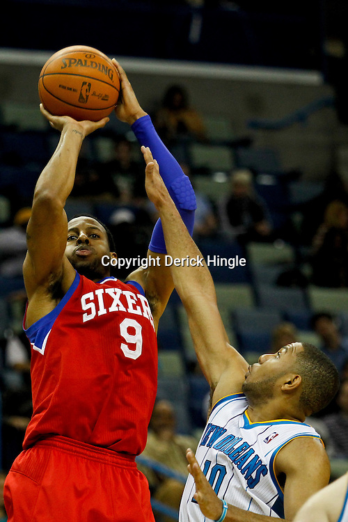 January 4, 2012; New Orleans, LA, USA; Philadelphia 76ers small forward Andre Iguodala (9) shoots over New Orleans Hornets shooting guard Eric Gordon (10) during the second half of a game at the New Orleans Arena. The 76ers defeated the Hornets 101-93.  Mandatory Credit: Derick E. Hingle-US PRESSWIRE