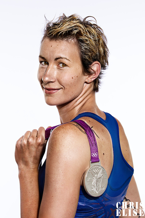 14 August 2012:  Olympic Silver Medalist Elodie Godin (Team France Basketball) poses with her silver medal, at the Hotel Concorde Lafayette, in Paris, France.