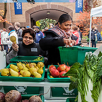Two customers select fresh vegetables and fruit from FoodShare's Mobile Good Food Market bus.