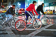 Fixed-gear cyclists on the streets of Manhattan, New York City, New York.