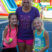 August 19, 2014, New Haven, CT:<br /> Coco Vandeweghe pose for a photograph with kids during a Girl Scout Night clinic on day five of the 2014 Connecticut Open at the Yale University Tennis Center in New Haven, Connecticut Tuesday, August 19, 2014.<br /> (Photo by Billie Weiss/Connecticut Open)