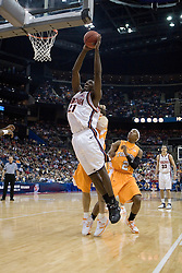 Virginia Cavaliers center Tunji Soroye (21) goes up for a shot against Tennessee.  The #4 seed Virginia Cavaliers were defeated by the #5 seed Tennessee Volunteers 77-74 in the second round of the Men's NCAA Tournament in Columbus, OH on March 18, 2007.