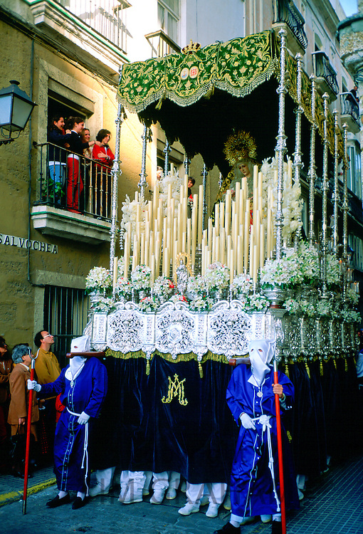 Procession for Semana Santa, the Holy Week parade, in Seville, Spain.  Religious icons are carried around the town in a respectful parade. RESERVED USE - NOT FOR DOWNLOAD -  FOR USE CONTACT TIM GRAHAM