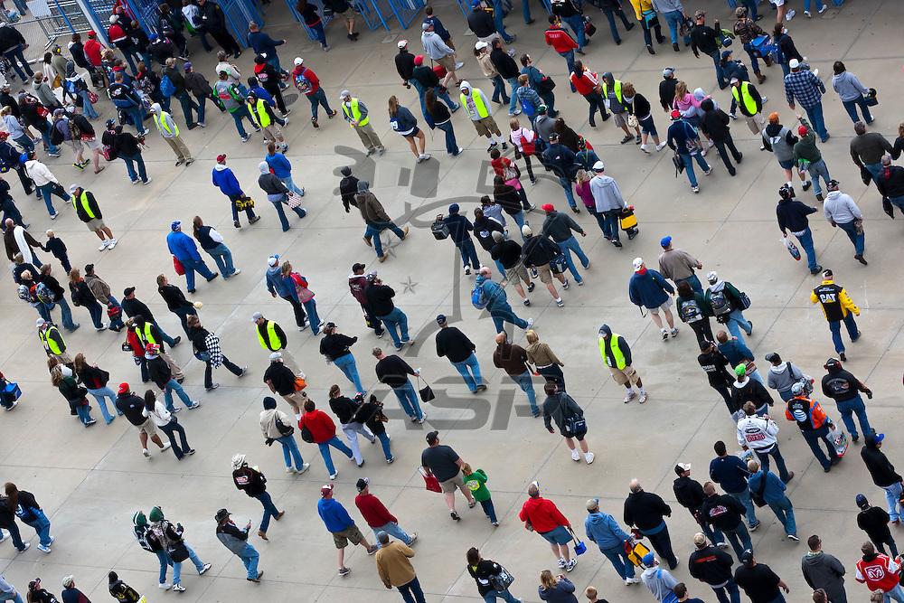 KANSAS CITY, KS - APR 22, 2012:  Fans depart the track after the STP 400 at the Kansas Speedway in Kansas City, KS.
