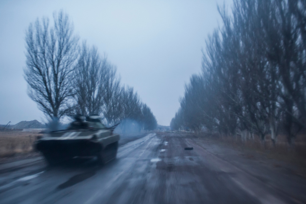 PIKSY, UKRAINE - NOVEMBER 19, 2014: A tracked armored personnel carrier belonging to the Ukrainian army drives on a road toward Pisky, Ukraine. The village of Pisky is the scene of much of the front-line fighting over the Donetsk airport. CREDIT: Brendan Hoffman for The New York Times