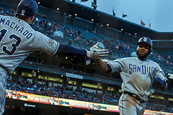 SAN FRANCISCO, CA - JUNE 12: Manuel Margot #7 of the San Diego Padres is congratulated by Manny Machado #13 after scoring a run against the San Francisco Giants during the fifth inning at Oracle Park on June 12, 2019 in San Francisco, California. The San Francisco Giants defeated the San Diego Padres 4-2. (Photo by Jason O. Watson/Getty Images) *** Local Caption *** Manuel Margot; Manny Machado