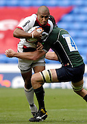 Reading, GREAT BRITAIN, Saracens Kameli RATUVOU, is tackled by exiles Nick KENNEDY,  during the EDF Energy Cup, rugby match, London Irish vs Saracens at the Madejski  Stadium, ENGLAND, 30/09/2006. [Photo, Peter Spurrier/Intersport-images].