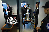Mike Bolt (OBSCURED), cup chaperone for the NHL, goes through a security checkpoint with the Stanley Cup for a breakfast reception with U.S. Senator John Kerry (D-MA) at the U.S. Capitol in Washington, February 29, 2012.