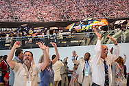 People dance at a welcome event for Democratic National Convention delegates from North Carolina, South Carolina, Virginia, Georgia and Tennessee at the NASCAR Hall of Fame on Sunday, September 2, 2012 in Charlotte, NC.