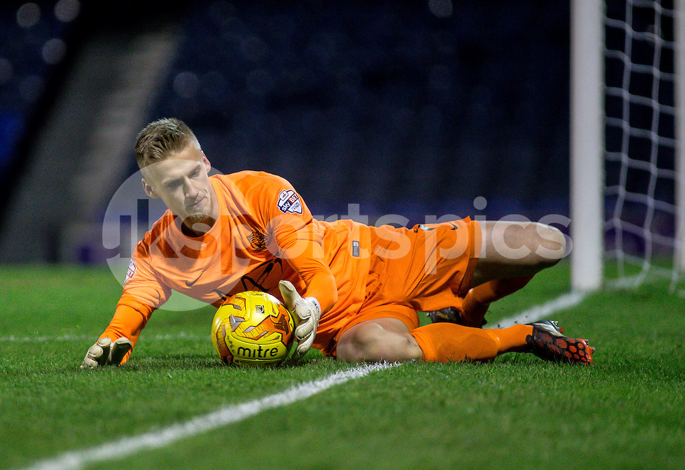 Daniel Bentley of Southend Utd slides and keeps the ball in during the Sky Bet League 2 match between Southend United and Burton Albion at Roots Hall, Southend, England on 19 December 2014. Photo by Liam McAvoy.