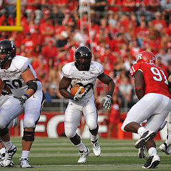 Sep 7, 2009; Piscataway, NJ, USA; Cincinnati defensive back Chris Williams (20) runs through a hole in the Rutgers defense during the first half of Rutgers 47-15 loss to Cincinnati in NCAA college football at Rutgers Stadium.