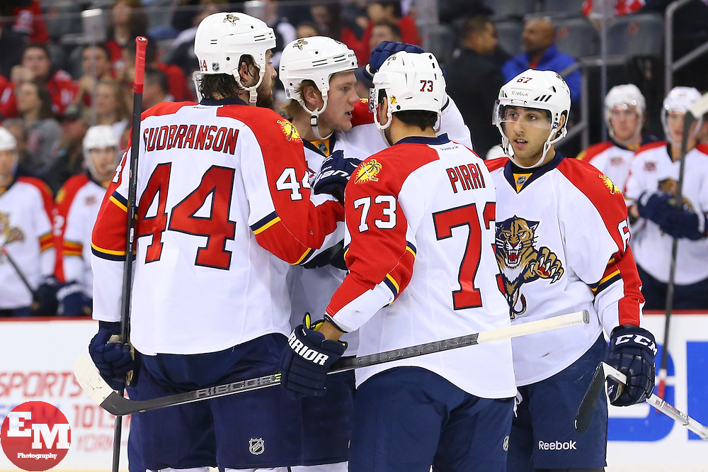 Mar 31, 2014; Newark, NJ, USA; The Florida Panthers celebrate a goal by Florida Panthers center Brandon Pirri (73) during the second period at Prudential Center.