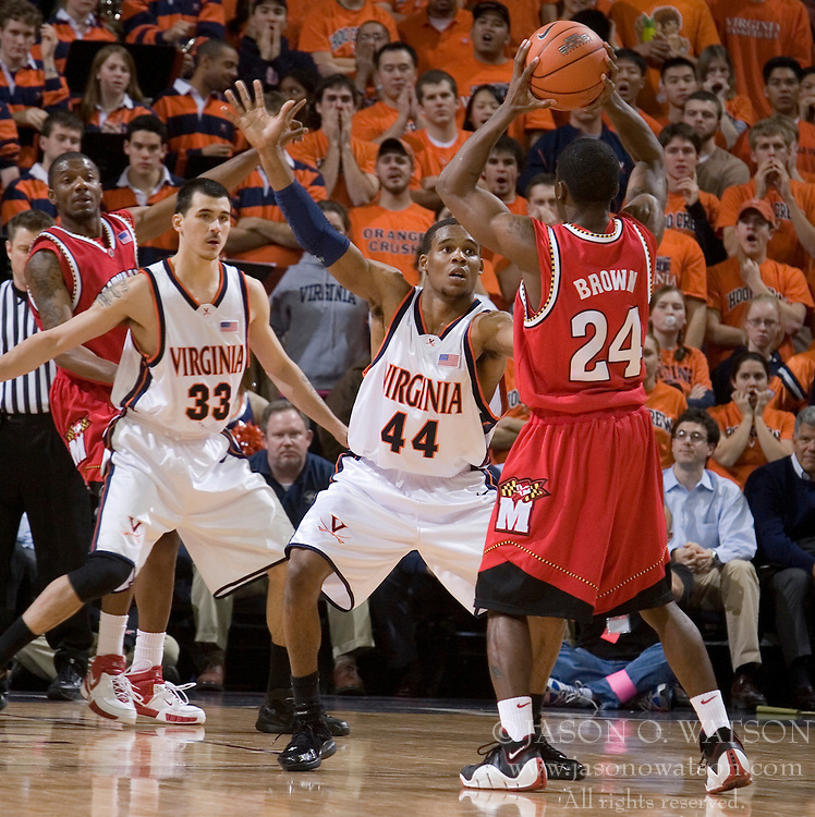 Maryland's Parrish Brown (24) is guarded by Virginia's Sean Singletary (44).  The Cavaliers defeated the #22 ranked Terrapins 103-91 at the John Paul Jones Arena in Charlottesville, VA on January 16, 2007.