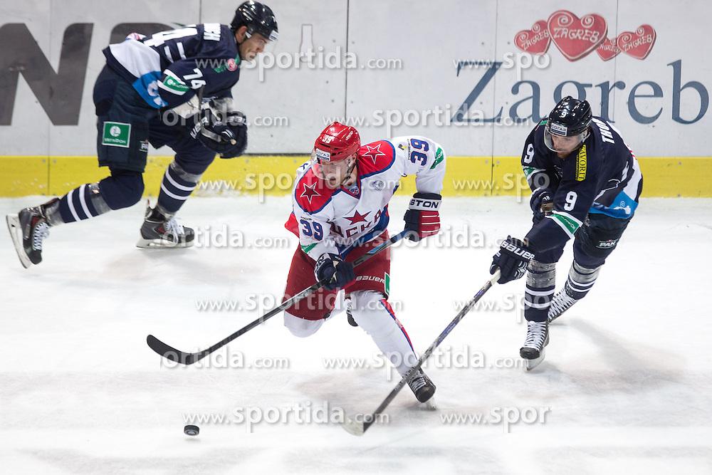 Jan Mursak of CSKA Moscow vs Thomas Bill of KHL Medvescak Zagreb during KHL League ice hockey match between KHL Medvescak Zagreb and CSKA Moscow, on September 18, 2014 in Dvorana Sportova, Zagreb, Croatia. (Photo By Matic Klansek Velej / Sportida)