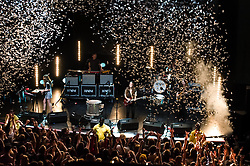 © Licensed to London News Pictures. 09/12/2013. London, UK.   Confetti explodes into the air during the climax of their live set as indie band Haim perform live at The Forum. In this pic - Alana Haim (left), Danielle Haim (centre), Este Haim (right).  Haim is an American indie rock band consists of sisters Este Haim (bass/vocals), Danielle Haim (guitar/vocals) and Alana Haim (guitar/vocals/keyboards) with drummer Dash Huttong<br /> <br /> Haim were nominated in the Brand New for 2013 category in the 2013 MTV Music Awards, and won the Sound of 2013 category in the BBC Sound of 2013 awards. <br /> <br /> Photo credit : Richard Isaac/LNP