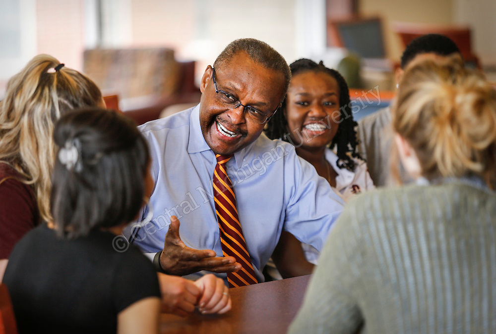 Dr. George E Ross meets with students in the FFOC dining area before and after filming an admission orientation video.  Photo by Steve Jessmore/ Central Michigan University
