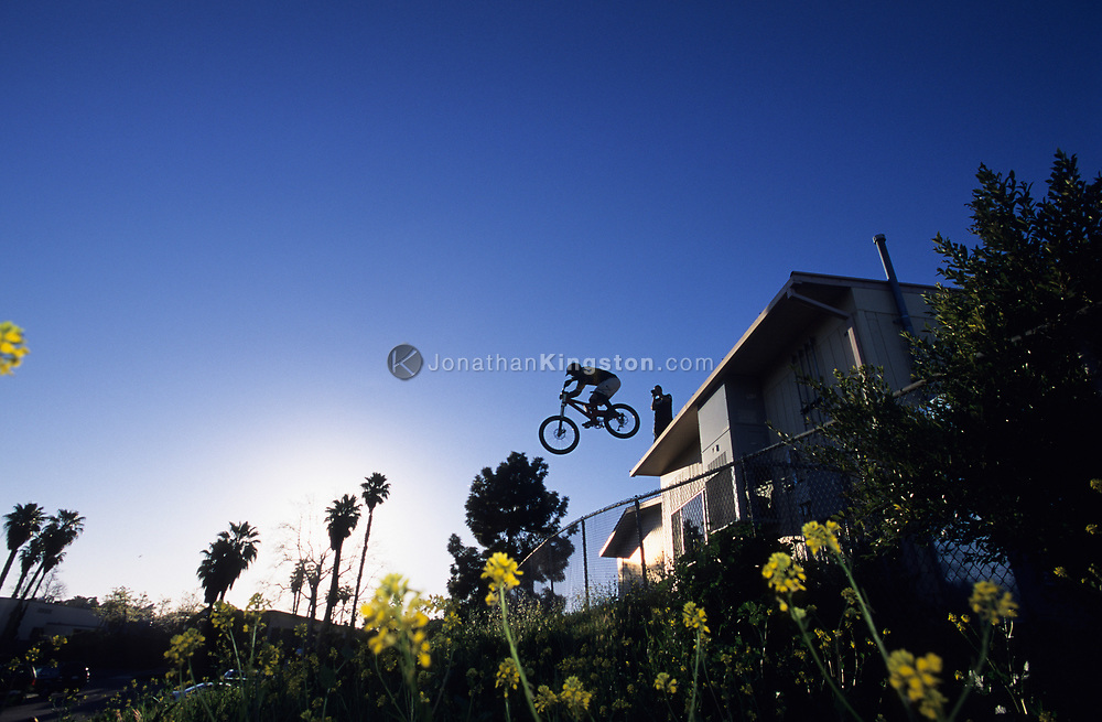 SANTA BARBARA, CA:  A man jumps his mountain bike off a building in Santa Barbara, California.