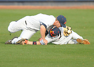MIssissippi rightfielder J.B. Woodman, left, drops the ball after colliding with second baseman Dalton Dulin (7) on a ball hit by Louisiana-Monroe's Kodie Tidwell, at Oxford-University Stadium in Oxford, Miss. on Tuesday, February 25, 2014. (AP Photo/Oxford Eagle, Bruce Newman)