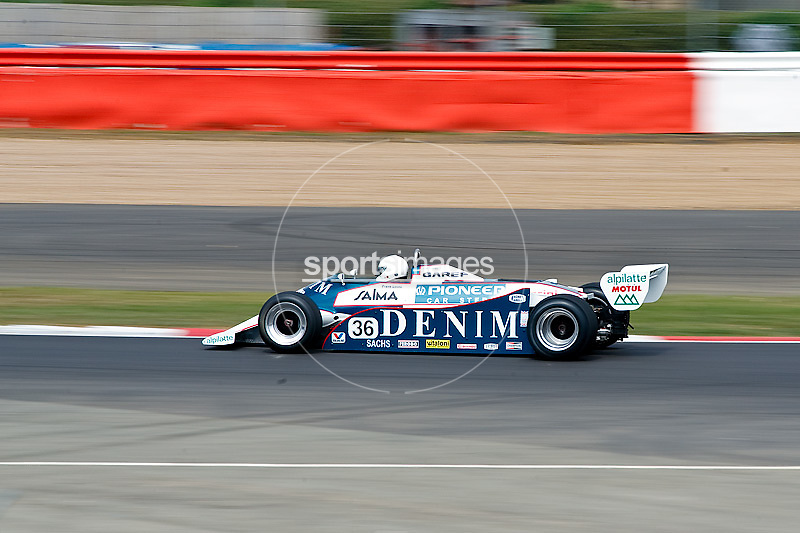 Car No 36 exit's abbey. Silverstone Classic - 66-85 F1- 25/7/10.