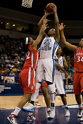 North Carolina guard/forward Rashanda McCants (32) shoots over Georgia guard Christy Marshall (22).  The #1 seed North Carolina Tar Heels defeated the Georgia Bulldogs 80-66 in the second round of the 2008 NCAA Women's Basketball Championship at the Ted Constant Convocation Center in Norfolk, VA on March 25, 2008.