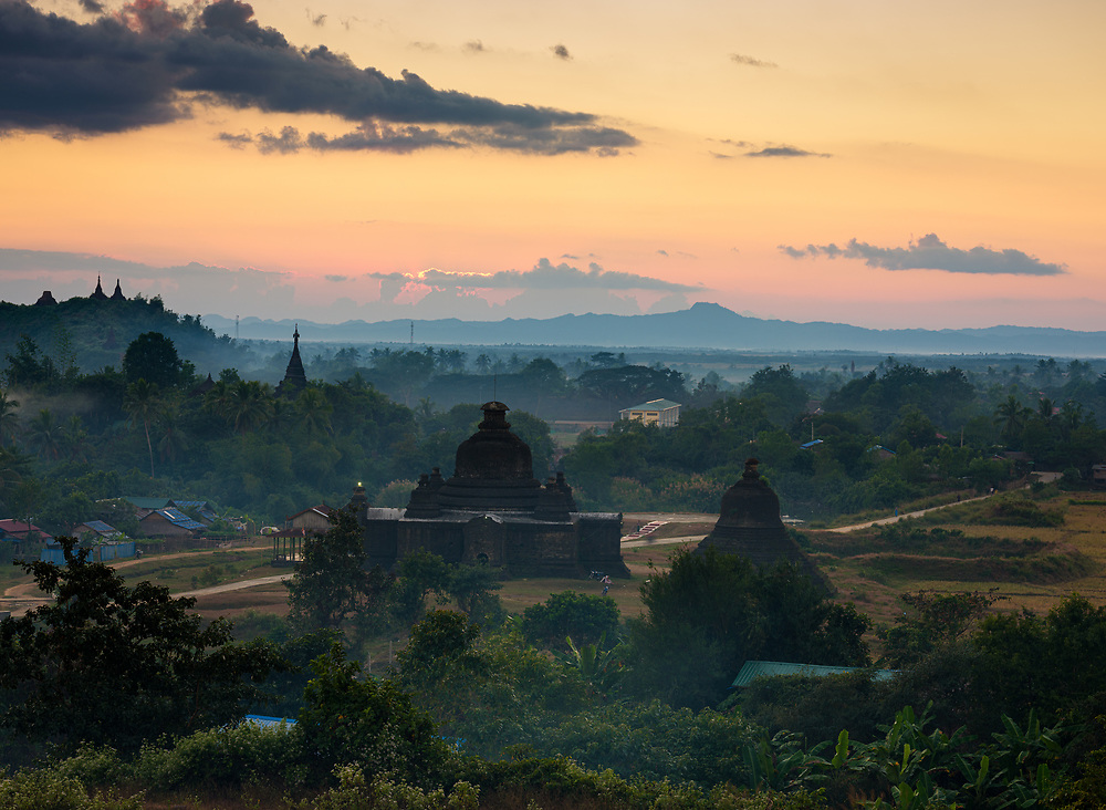 MRAUK U, MYANMAR - CIRCA DECEMBER 2017: Sunset over the hills of Mrauk U in Myanmar