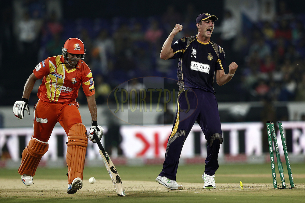 Patrick Cummins of the Kolkata Knight Riders celebrates the wicket of  Nasir Jamshed of the LAHORE LIONS during match 7 of the Oppo Champions League Twenty20 between the Kolkata Knight Riders and the Lahore Lions held at the Rajiv Gandhi Cricket Stadium, Hyderabad, India on the 21st September 2014<br /> <br /> Photo by:  Deepak Malik / Sportzpics/ CLT20<br /> <br /> <br /> Image use is subject to the terms and conditions as laid out by the BCCI/ CLT20.  The terms and conditions can be downloaded here:<br /> <br /> http://sportzpics.photoshelter.com/gallery/CLT20-Image-Terms-and-Conditions-2014/G0000IfNJn535VPU/C0000QhhKadWcjYs