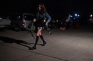 Rachel Trachtenburg of The Prettiots loads in her gear before a show during 35 Denton at Rubber Gloves in Denton, Texas on March 15, 2015. (Cooper Neill for The New York Times)