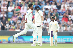 England's Joe Root shows his dejection as Pakistan's Mohammad Amir celebrates taking his wicket during day two of the Second Natwest Test match at Headingley, Leeds.