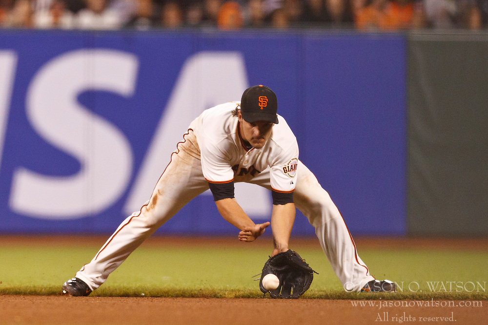 SAN FRANCISCO, CA - JULY 30:  Ryan Theriot #5 of the San Francisco Giants fields a ground ball against the New York Mets during the seventh inning at AT&T Park on July 30, 2012 in San Francisco, California. The New York Mets defeated the San Francisco Giants 8-7 in 10 innings. (Photo by Jason O. Watson/Getty Images) *** Local Caption ***