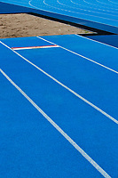 Photo of blue stadium tracks