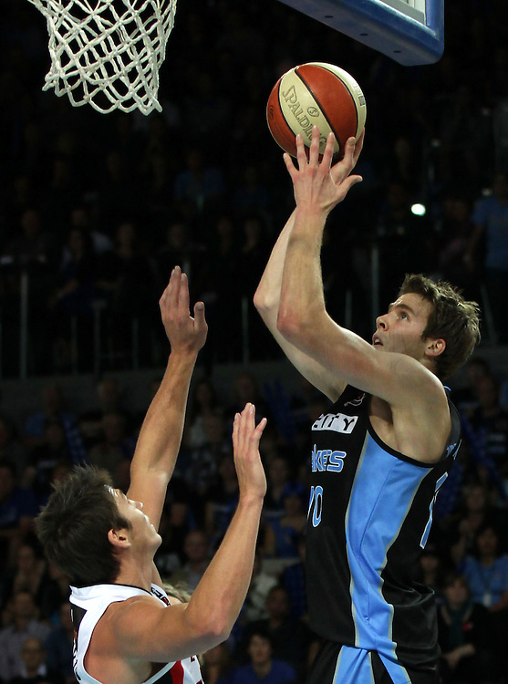 Breakers' Thomas Abercrombie takes a shot defended by Wildcats' Damian Martin in the 3rd and deciding grand final match of the ANBL Basketball Championship, Vector Arena, Auckland, New Zealand, Tuesday, April 24, 2012.  Credit:SNPA / David Rowland