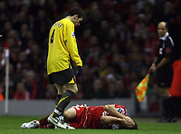 Photo: Paul Thomas.<br /> Liverpool v Arsenal. Carling Cup. 09/01/2007.<br /> <br /> Mark Gonzalez lays injured on the floor (Later goes off on a stretcher) and is seen too by Cesc Fabregas of Arsenal.