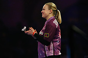 Anastasia Dobromyslova congratulates Ryan Joyce, claps, applauds, during the World Championship Darts 2018 at Alexandra Palace, London, United Kingdom on 17 December 2018.