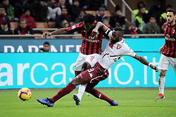 December 9, 2018 - Milan, Milan, Italy - Frank Kessie #79 of AC Milan competes for the ball with Nicolas Nkoulou #33 of Torino FC during the serie A match between AC Milan and Torino FC at Stadio Giuseppe Meazza on December 09, 2018 in Milan, Italy. (Credit Image: © Giuseppe Cottini/NurPhoto via ZUMA Press)