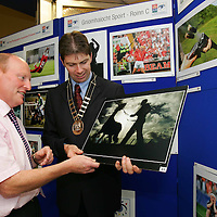 Michael Earley , Deputy Manager AIB Ennis (left) and Cllr Joe Reidy, Mayor of Ennis at the opening of the AIB/ Press Photographers Association of Ireland awards exhibition at the AIB branch, Ennis, Co. Clare .  - Photo : Kieran Clancy / PicSure © 12/9/06