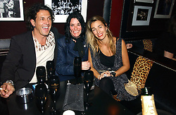 Left to right, jeweller STEPHEN WEBSTER, artist SUE WEBSTER and ASSIA WEBSTER at a Black, White and Gold party to celebrate the December 'Party' issue of Harper's Bazaar featuring the 'Going Out' Guide in association with Moet & Chandon  held at Ronnie Scotts, 47 Frith Street, London on 16th November 2006.<br />
