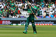 Wicket - Imad Wasim of Pakistan looks angry with himself as he walks back to the pavilion after being dismissed by Mustafizur Rahman of Bangladesh during the ICC Cricket World Cup 2019 match between Pakistan and Bangladesh at Lord's Cricket Ground, St John's Wood, United Kingdom on 5 July 2019.