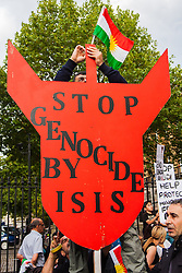 "London, August 13th 2014. Dozens of London's Kurdish and Yazidi community demonstrate outside the gates of Downing Street against the unfolding genocide against their people in Iraq by terror organisation ISIS, now known as the ""Islamic State""."