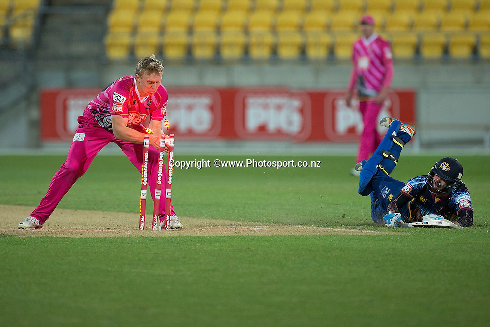Roald Badenhorst (R of the Otago Volts slides to safety as  Scott Kuggeleijn of the Knights takes off the bails during the Georgie Pie Super Smash Volts v Knights cricket match at the Westpac Stadium in Wellington on Sunday the 23rd of November 2014. Photo by Marty Melville/www.Photosport.co.nz